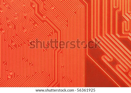 Macro shot of the backside of a computer circuit board or motherboard. - stock photo