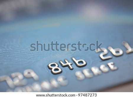 Macro shot of three digits of a whole credit card number, closeup - stock photo