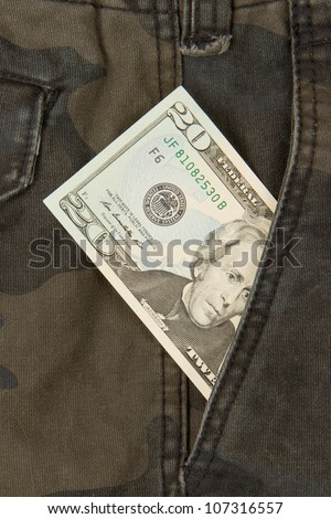 Macro shot of trendy jeans with american 20 dollar bill on its pocket - stock photo