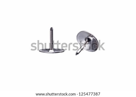 Macro Shot of two Drawing pins, isolated on white background - stock photo