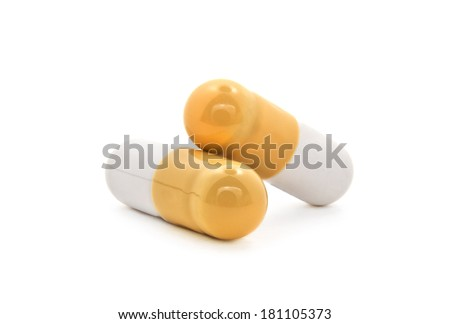 Macro shot of two pills with medical drug inside - stock photo