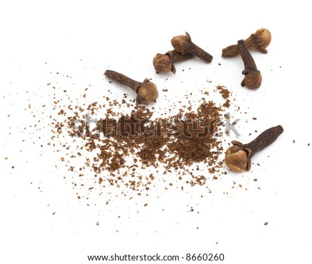 Macro shot of whole and ground cloves. One in a current series of 6 multi-form spice macros. - stock photo