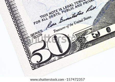 macro shot with fifty dollar bill isolated on white background - stock photo