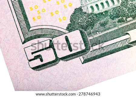 Macro shot with fifty U.S. dollar bill isolated on white. - stock photo