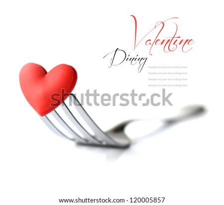 Macro studio image of stainless steel fork with red heart. Concept image for Valentine dinner/love food/love cooking etc. Differential focus with shallow DOF. Copy space. - stock photo