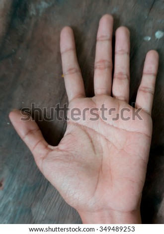 Macro view of a finger print on a human hand - stock photo