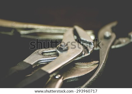 Macro view of a group of wrenches, shallow DOF - stock photo