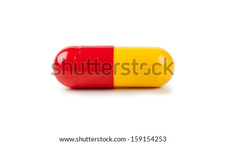 Macro view of capsule pill isolated over white background - stock photo