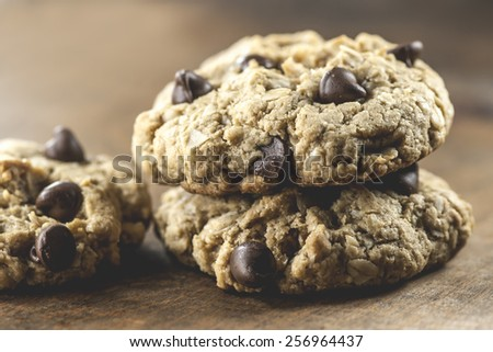 Macro view of chocolate chip cookies on wooden table (Shallow Depth-of-Field) - stock photo
