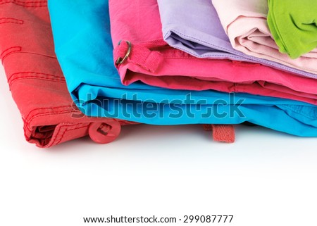 Macro view of colorful clothes on white background - stock photo