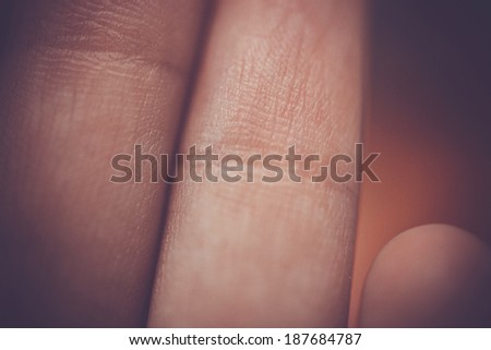 Macro view of fingers on a women - stock photo