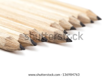 Macro view of group of lead pencils over white background - stock photo