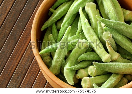macro view of okra on wooden background - stock photo