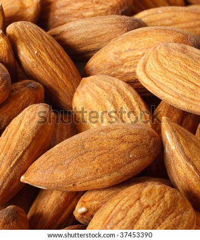 Macro view of  pile of perfect almonds - stock photo