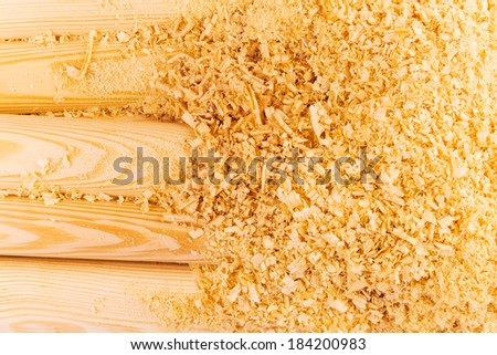 Macro view of wooden sawdust and logs - stock photo