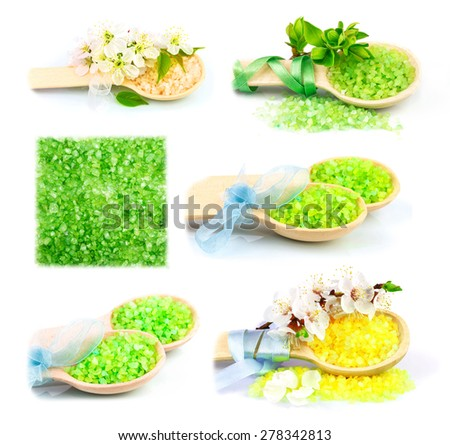 Macro view of wooden spoons with color bath salt and flowers, set isolated on white background - stock photo