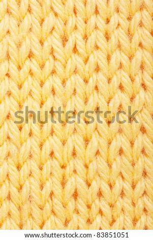 Macro view of yellow knitting. - stock photo