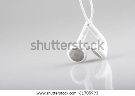 macro with white earphones - stock photo