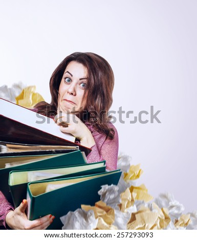 Mad faced teacher with folders in hands - stock photo