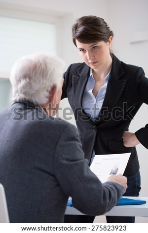 Mad female boss during interview in the office - stock photo