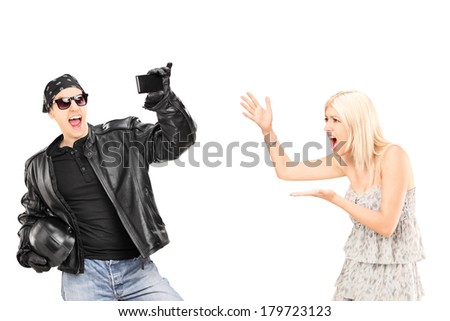 Mad woman yelling at her biker boyfriend isolated on white background - stock photo