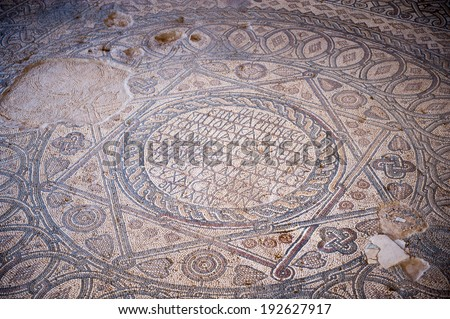 MADABA, JORDAN - APR 28, 2014: Huge mosaics in the Hippolytus Hall in the Archaeological Museum of Madaba. It's the place where some mosaics from the 5th to 7th are preserved - stock photo