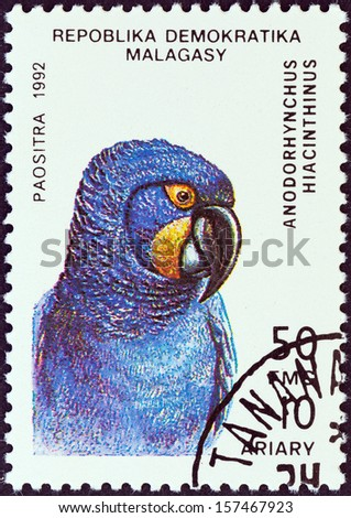 """MADAGASCAR - CIRCA 1992: A stamp printed in Madagascar from the """"Birds"""" issue shows a Hyacinth Macaw (Anodorhynchus hyacinthinus), circa 1992.  - stock photo"""