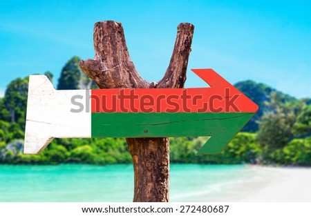 Madagascar Flag wooden sign with beach background - stock photo
