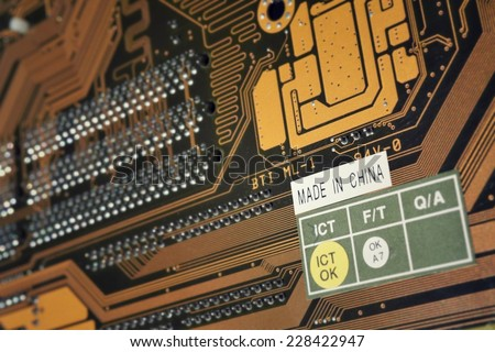Made in China label on the computer motherboard  - stock photo