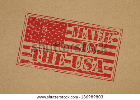Made in the USA rubber stamp impression on brown paper background - stock photo