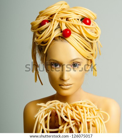 made-up girl model with the pasta in the hands - stock photo