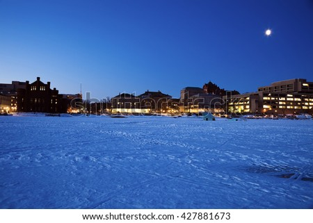 Madison seen from frozen lake - stock photo