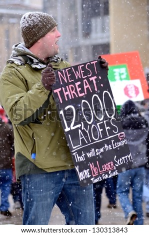 MADISON, WI - FEB 26:Protesters in Wisconsin during a rally against Governor Scott Walker's budget bill on Feb 26, 2011. Walker has won the recall election, but he still faces a new election next year - stock photo