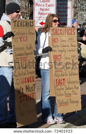 MADISON, WI - FEB 19: Unidentified people protest WI Budget Repair Bill on February 19, 2011 on the capitol square in Madison, WI.  The protesters hold signs supporting public school teachers. - stock photo
