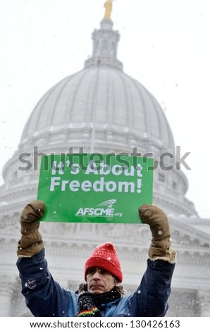 MADISON, WI - FEB 26: Union supporter  in Wisconsin in a rally against Governor Scott Walker's budget on Feb 26, 2011. Walker has won the recall election, but he still faces a new election next year - stock photo