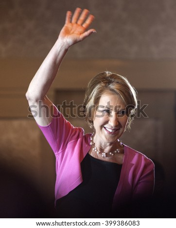 MADISON, WI/USA - March 30, 2016: Former Republican presidential candidate Carly Fiorina waves to a group of supporters during a rally for presidential candidate Ted Cruz in Madison, Wisconsin. - stock photo