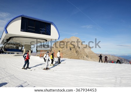 MADONNA DI CAMPIGLIO, ITALY - DECEMBER 18: Ski slope and skiers at Passo Groste on December 18, 2015 in Madonna di Campiglio, Italy. More then 46 mln tourists is expected to visit Italy in year 2015. - stock photo