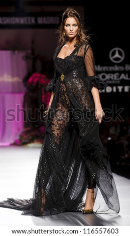 MADRID - AUGUST 31: A model walks on the Francis Montesinos catwalk during the Cibeles Madrid Fashion Week runway on August 31, 2012 in Madrid. - stock photo
