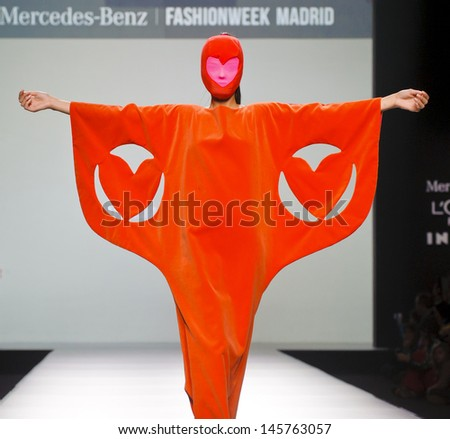 MADRID - FEBRUARY 20: A model walks on the Agatha Ruiz de la Prada  catwalk during the Cibeles Madrid Fashion Week runway on February 20, 2013 in Madrid. - stock photo