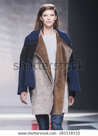 MADRID - FEBRUARY 10: a model walks on the Ailanto catwalk during the Mercedes-Benz Fashion Week Madrid Fall/Winter 2015 runway on February 10, 2015 in Madrid.  - stock photo