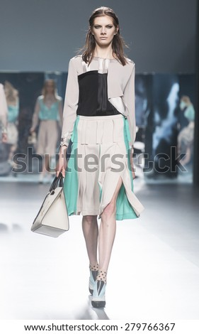 MADRID - FEBRUARY 09: a model walks on the Ana Locking catwalk during the Mercedes-Benz Fashion Week Madrid Fall/Winter 2015 runway on February 09, 2015 in Madrid.  - stock photo