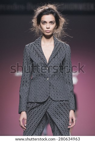 MADRID - FEBRUARY 09: a model walks on the Anabel Baldaque catwalk during the Mercedes-Benz Fashion Week Madrid Fall/Winter 2015 runway on February 09, 2015 in Madrid.  - stock photo