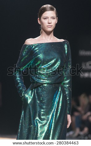 MADRID - FEBRUARY 09: a model walks on the Juanjo Oliva catwalk during the Mercedes-Benz Fashion Week Madrid Fall/Winter 2015 runway on February 09, 2015 in Madrid.  - stock photo