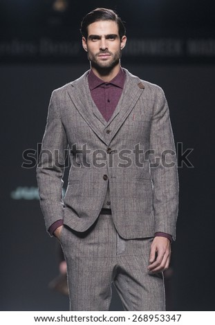 MADRID - FEBRUARY 09: a model walks on the Julio Torcato catwalk during the Mercedes-Benz Fashion Week Madrid Fall/Winter 2015 runway on February 09, 2015 in Madrid.  - stock photo
