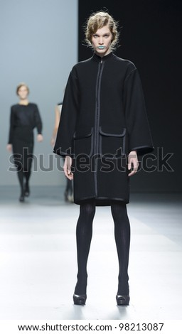 MADRID  FEBRUARY 02: A model walks on the Lemoniez catwalk during the Mercedes-Benz Fashion Week Madrid runway on February 02, 2012 in Madrid, Spain. - stock photo