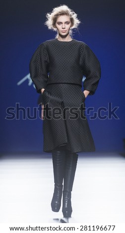 MADRID - FEBRUARY 09: a model walks on the Miguel Vieira catwalk during the Mercedes-Benz Fashion Week Madrid Fall/Winter 2015 runway on February 09, 2015 in Madrid.  - stock photo
