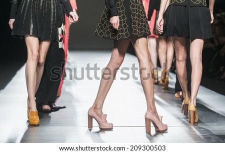 MADRID - FEBRUARY 15: details of shoes an dresses on the Teresa Helbig catwalk during the Mercedes-Benz Fashion Week Madrid Fall/Winter 2014-2015 runway on February 15, 2014 in Madrid.  - stock photo