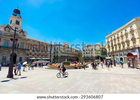 MADRID - JUNE,18: Tourists visit famous place Plaza Puerta del Sol on June 18, 2015 in Madrid - stock photo