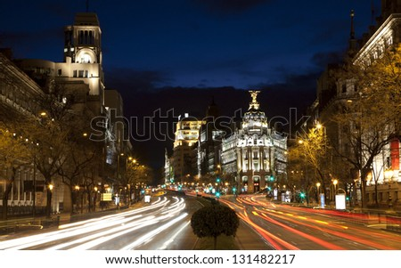 Madrid - look from Plaza de Cibeles in dusk to Cale de Alcala street and Metropolis building - stock photo