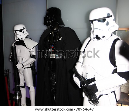 MADRID - MARCH 28: Darth Vader between two Storm Troopers. Star Wars exhibition during the presentation of the new Star Wars game for Kinect XBOX 360 at the Sports Palace on March 28, 2012 in Madrid - stock photo